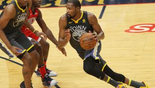Kevon Looney, Jrue Holiday i Kevin Durant