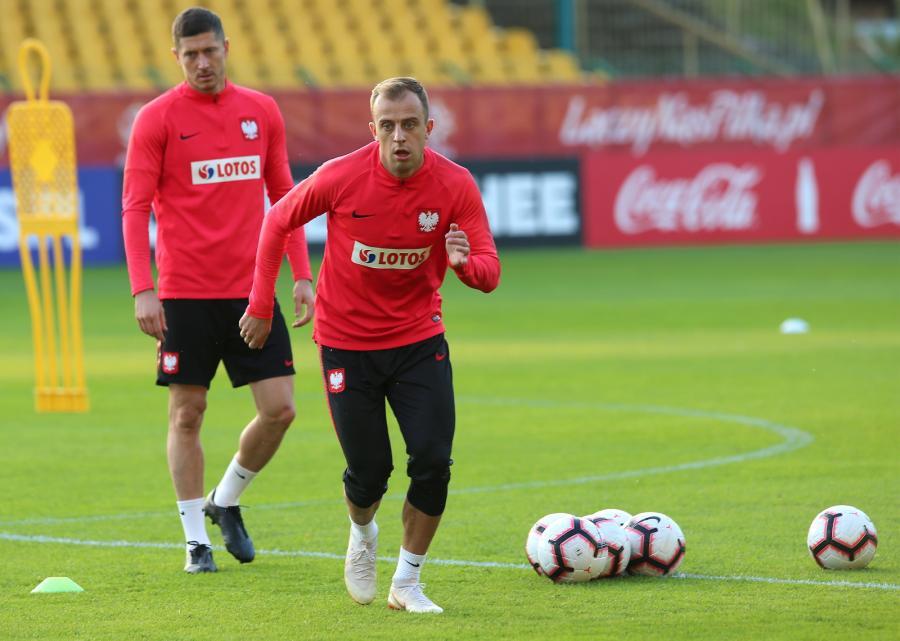 Zawodnicy reprezentacji Polski Robert Lewandowski (L) i Kamil Grosicki (P) podczas treningu w Katowicach