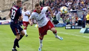 Piłkarz Pogoni Szczecin Marcin Listkowski (L) oraz Jan Grzesik (C) i Jan Sobociński (P) z ŁKS Łódź podczas meczu Ekstraklasy